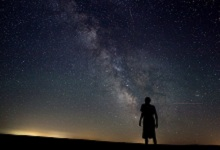 Person looking at stars in the spacious sky